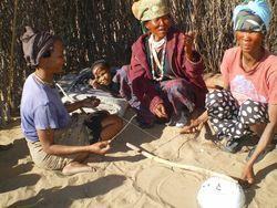 Women playing tandiri [dakateri] musical bow